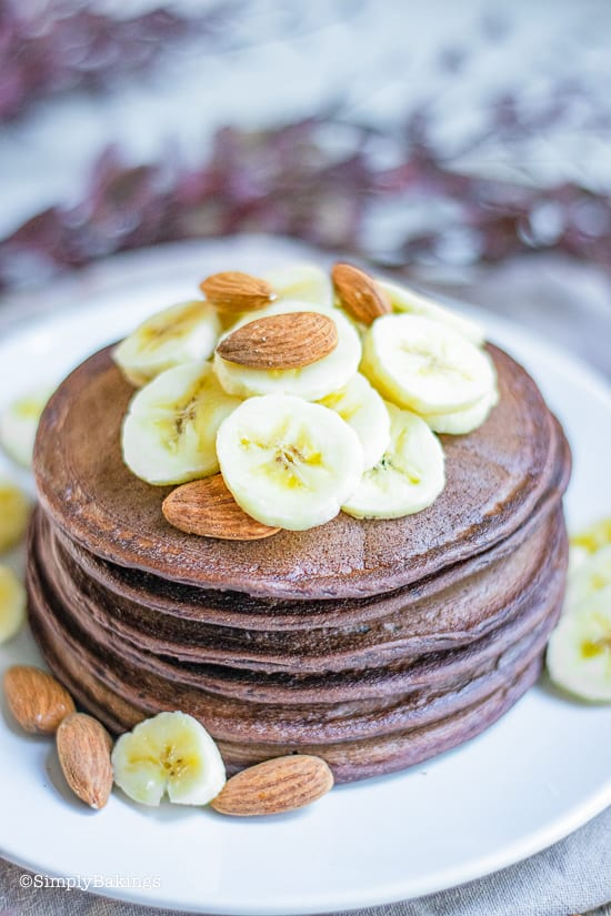 gluten free chocolate banana pancakes on a white plate