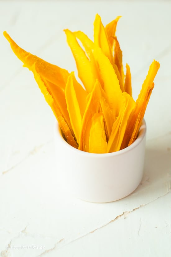 dried mangos in a white cup