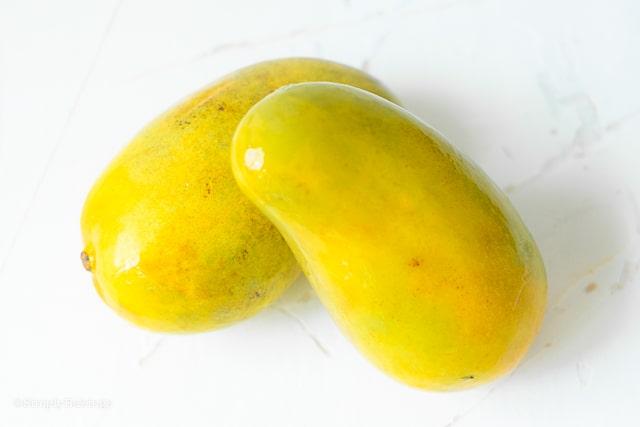 2 filipino mangos on a white table
