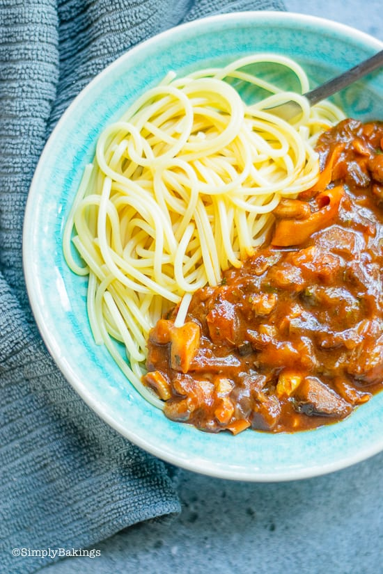 vegan bolognese in a blue bowl not mixed