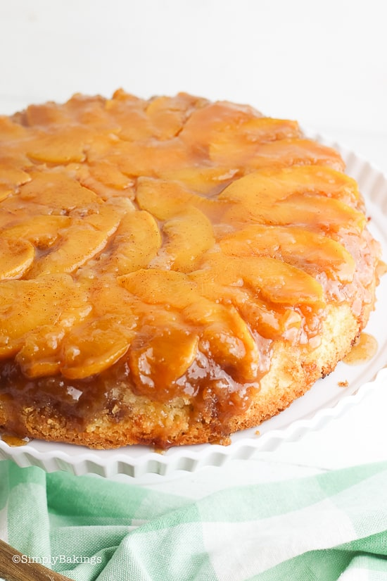 Peach Upside Down Cake on a white stand