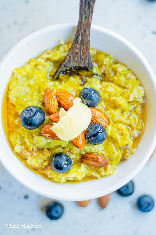 vegan pumpkin oatmeal with blueberries in a white bowl
