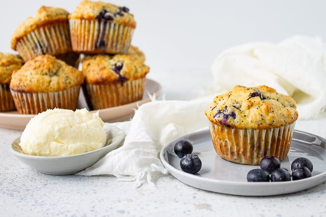blueberry lemon poppy seed muffins on a blue plate