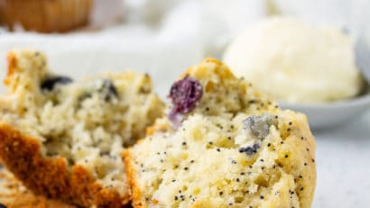 blueberry lemon poppy seed muffins halved on a table
