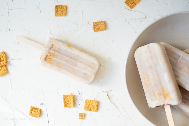 cinnamon crunch popsicles laying on a white surface