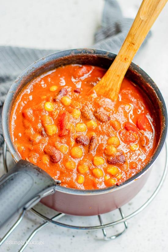 pumpkin chili simmering in a saucepan