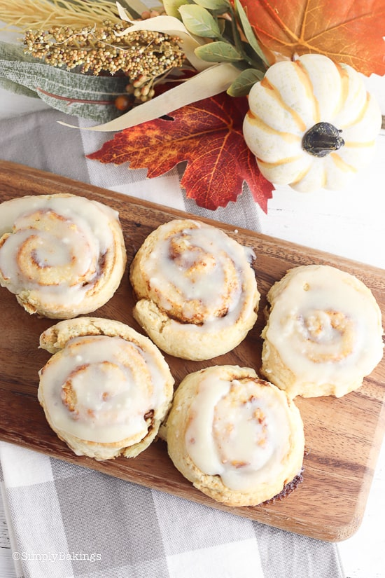 no yeast pumpkin cinnamon rolls on a brown cutting board