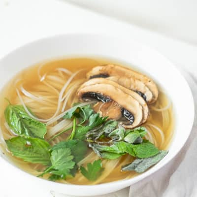 vegan pho with mushrooms and basil in a bowl