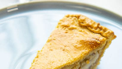 Single slice buko pie on a blue plate