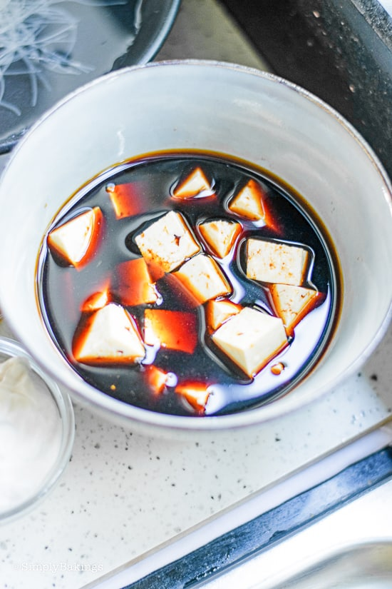 marinating tofu in soy sauce and water
