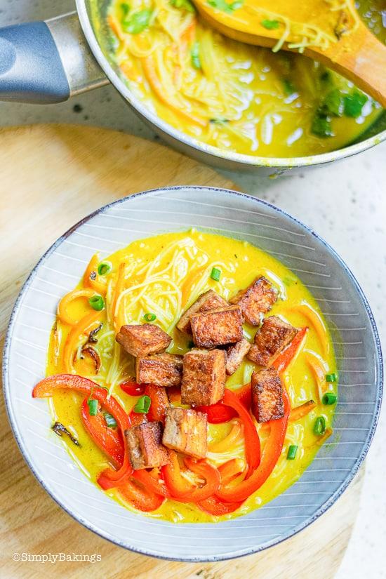 thai noodle soup in blue bowl