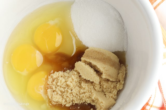 eggs, white sugar and brown sugar together in a large white bowl