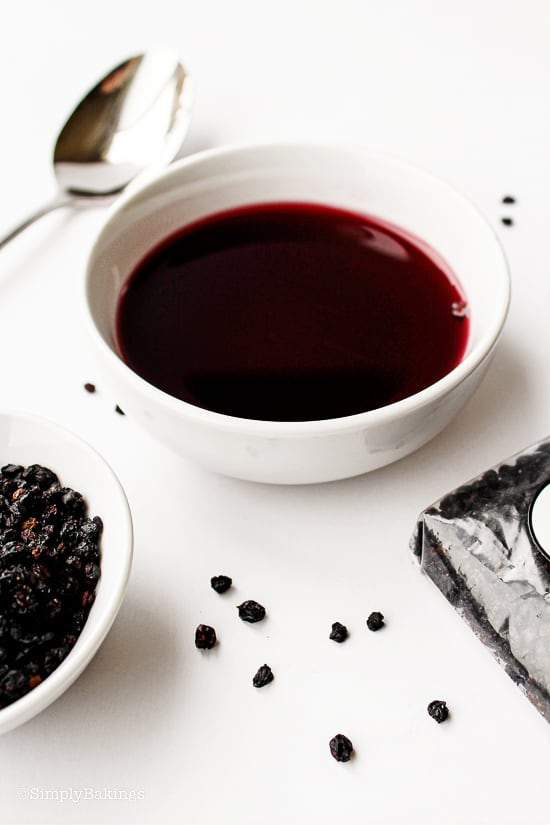 elderberry syrup in a small white bowl