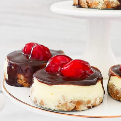 mini cherry chessecakes on a cake stands