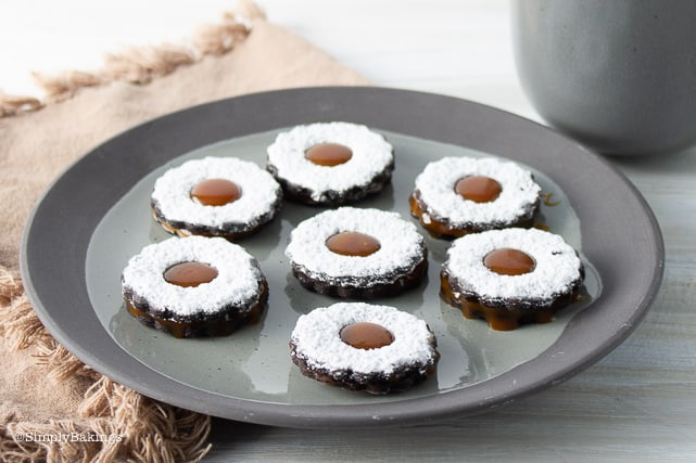 Vegan Chocolate Caramel Sandwich Cookies on a gray plate