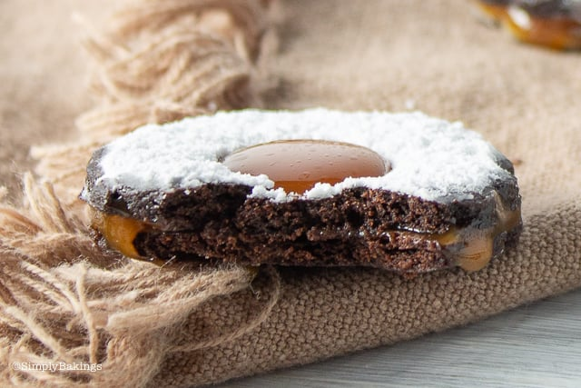 Caramel filled chocolate cookies on a brown cloth