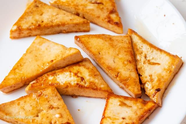 triangular slices of pan fried tofu