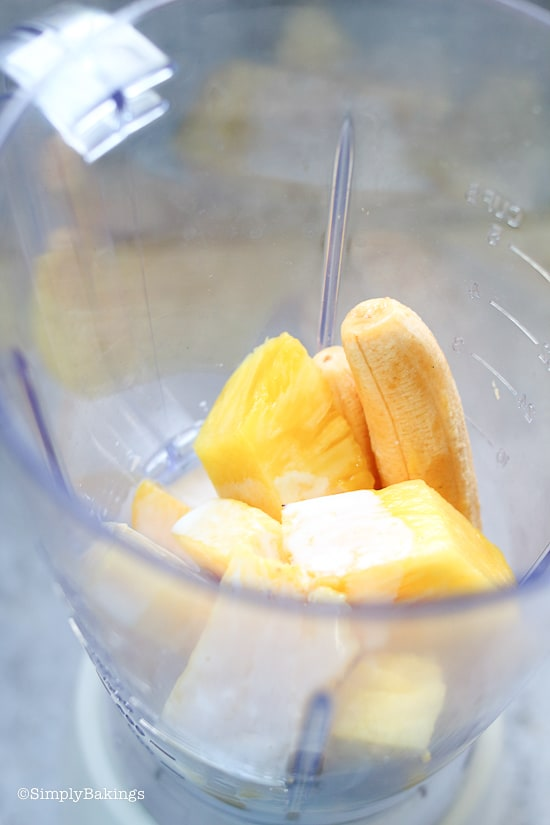 peeled bananas, sliced pineapples, coconut milk and lemon juice in a blender