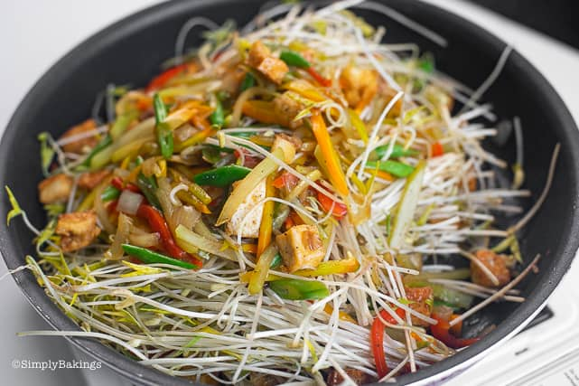 sautéed vegetables, tofu and mung bean sprouts in the pan