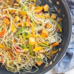 a bowl of stir fried mung bean sprouts with tofu and vegetables