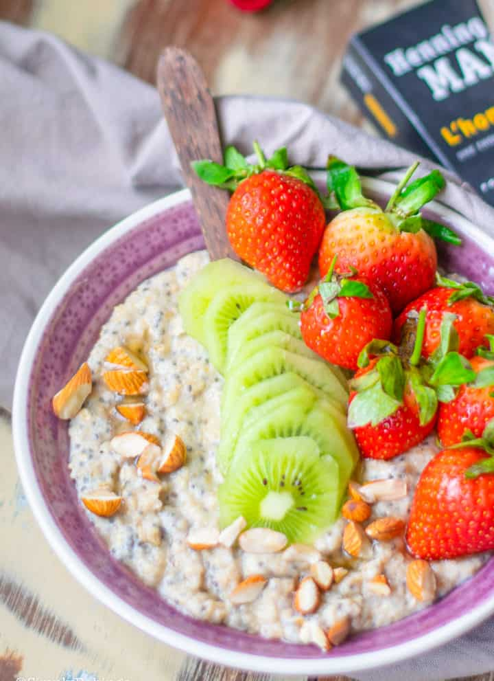 a bowl of spicy oats and chia porridge with a wooden spoon