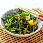a bowl of stir fried Green Beans with Black Bean Sauce with chopsticks