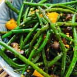 a bowl of stir fried green beans with black bean sauce