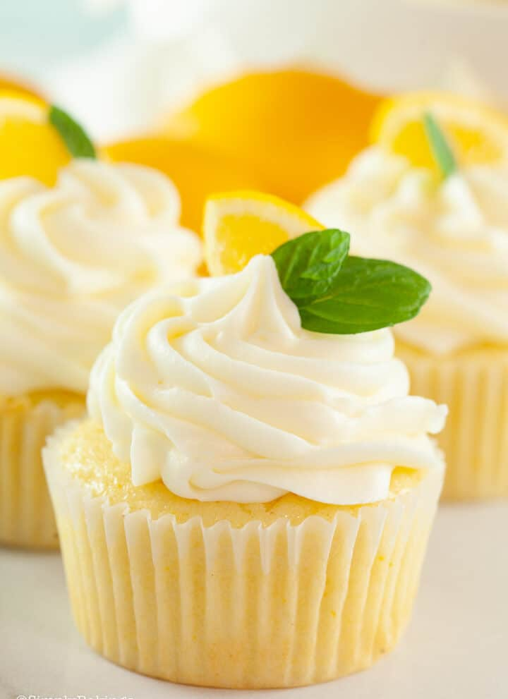 lemon cupcakes topped with cream cheese frosting