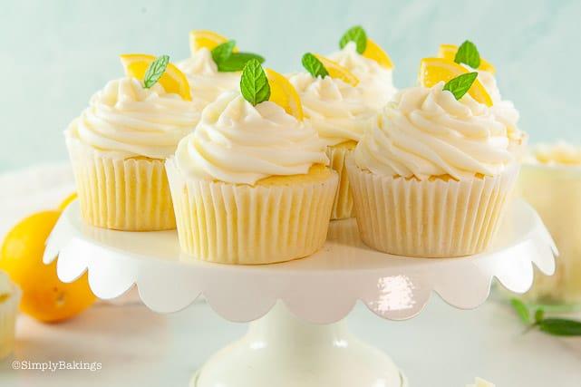 lemon cupcakes on a white round cupcake stand