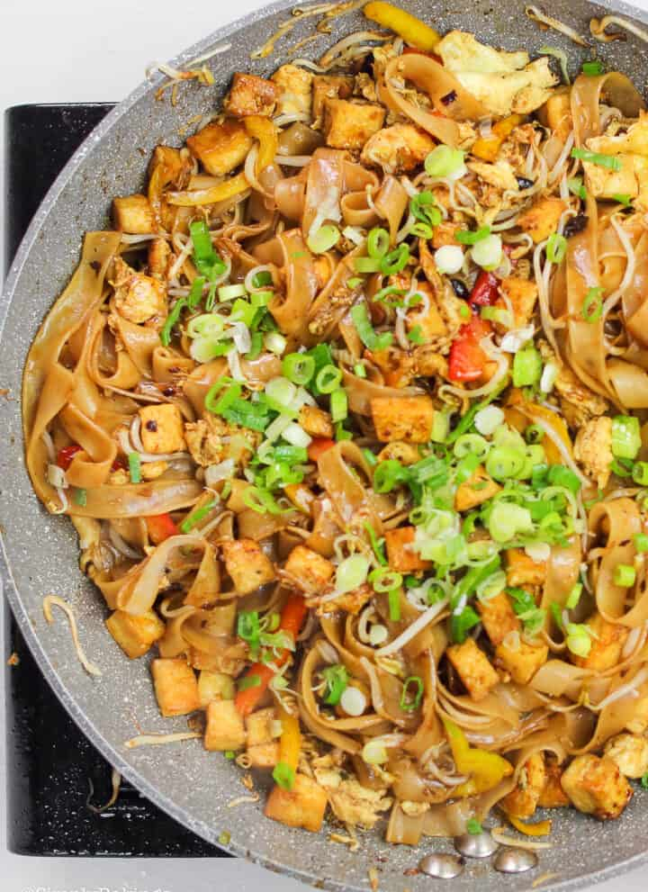 Malaysian Stir Fried Noodles)in a large pan and garnished with green onions