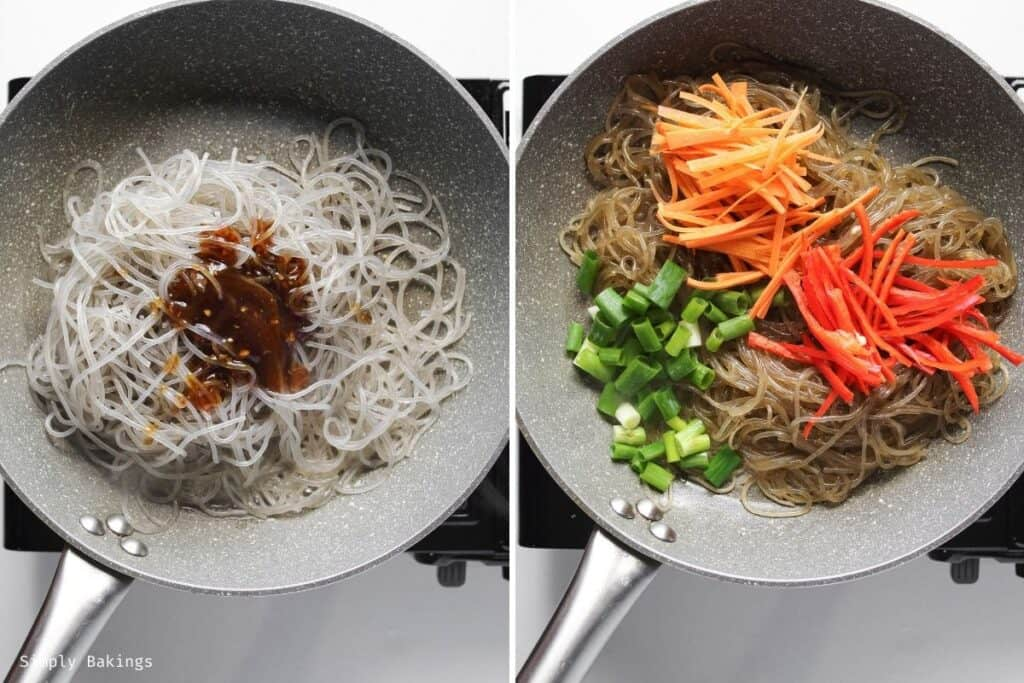 cooking noodles, sauce, green onions, carrots and bell pepper cooked in a large pan