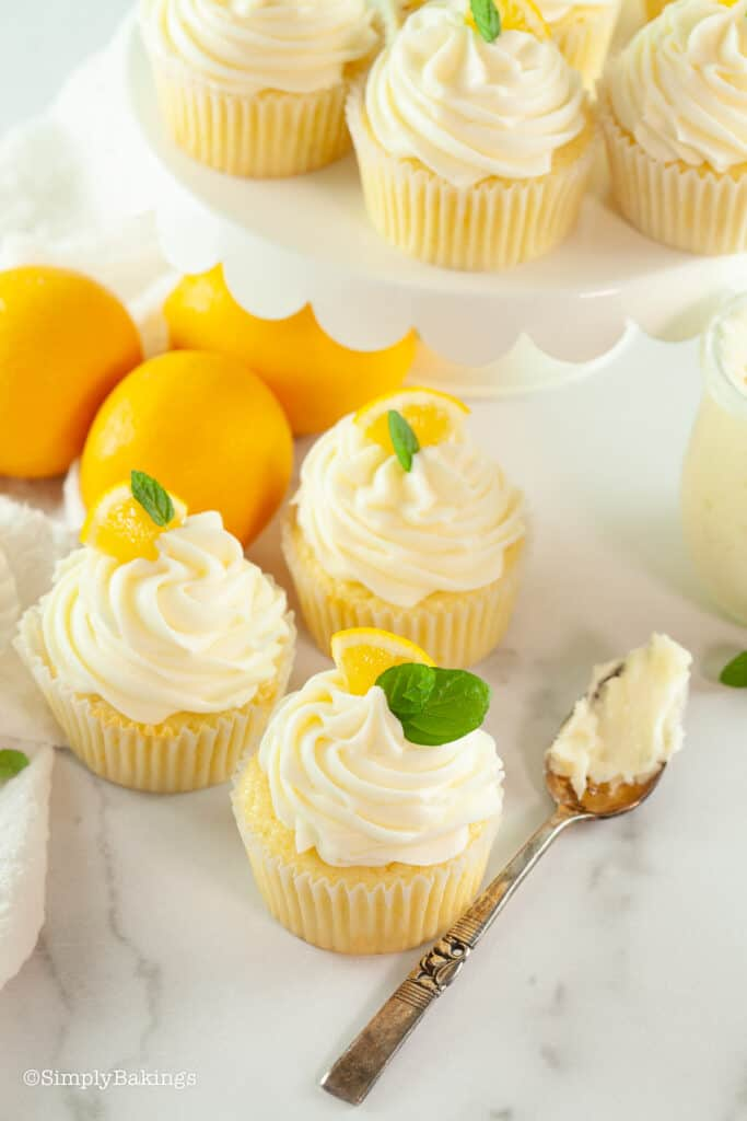 lemon cupcakes on counter and cake stand