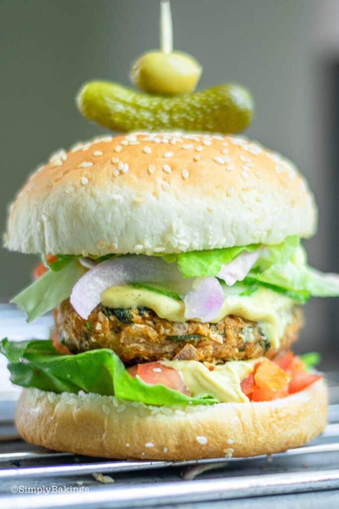 a vegan oat burger on  cooling rack