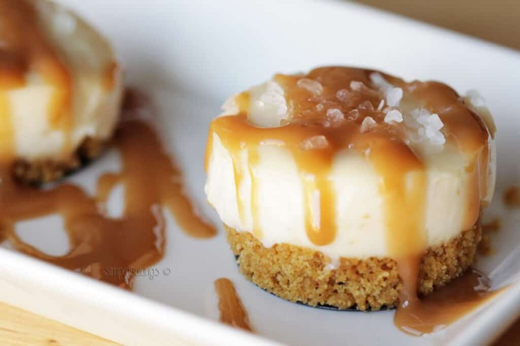 mini salted caramel cheesecakes on a white plate