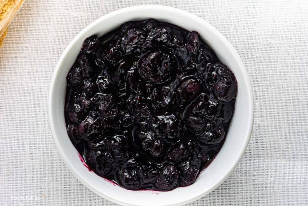 mashed blueberries on a white bowl