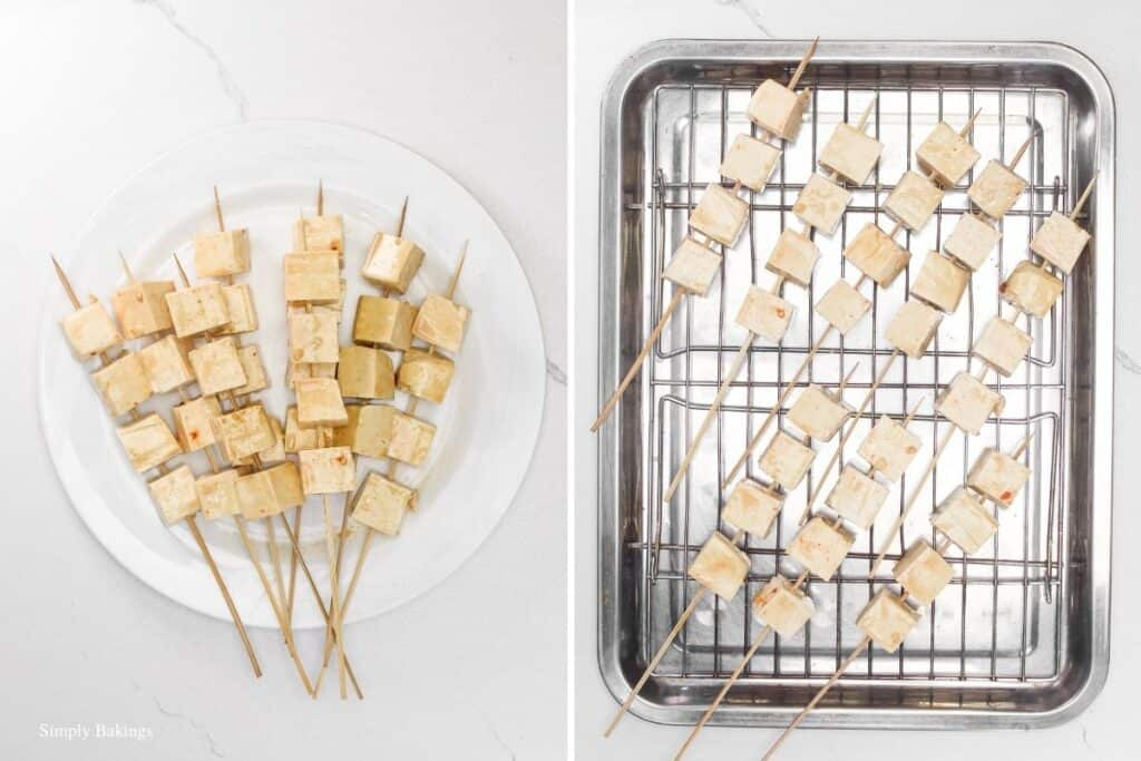 tofu cubes placed on skewers then arranged on a wire rack to bake