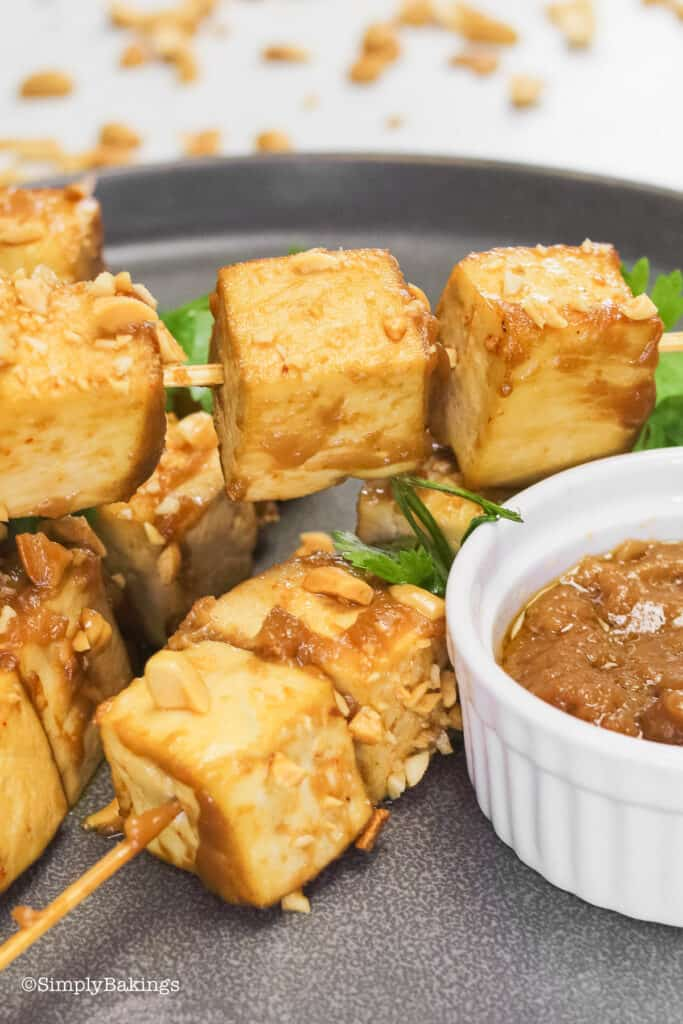tofu sayang with peanut sauce on a gray plate