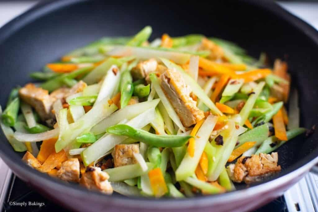 added the chayote, baguio beans, carrots into the pan