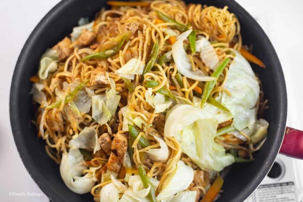 mixed in the pre-soaked sotanghon noodles, pancit canton noodles, cabbage