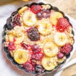 deliciously baked berries banana oats in a baking dish