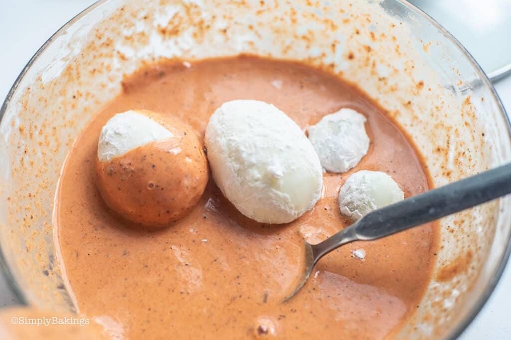 dipped each egg in the orange batter