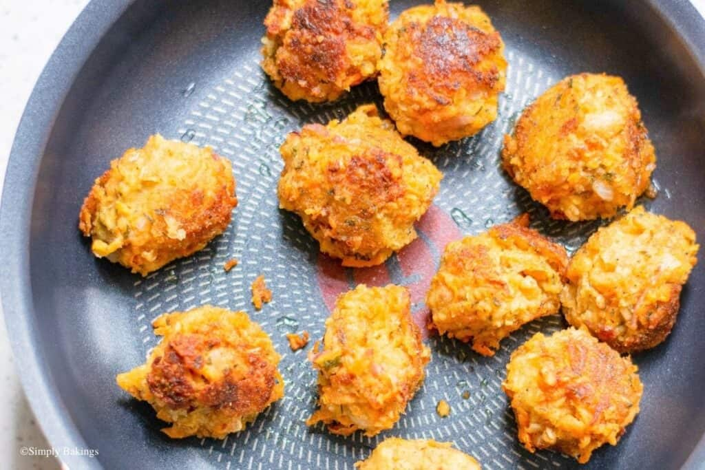 fried vegan meatballs in a large non-stick pan