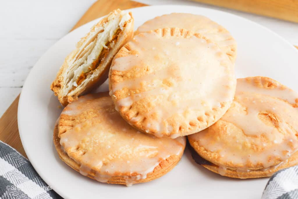 air-fried mini pumpkin pies on a white plate