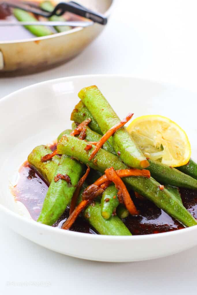 delicious okra dish with a slice of lemon on a white bowl