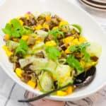 savory mango salad in a large bowl