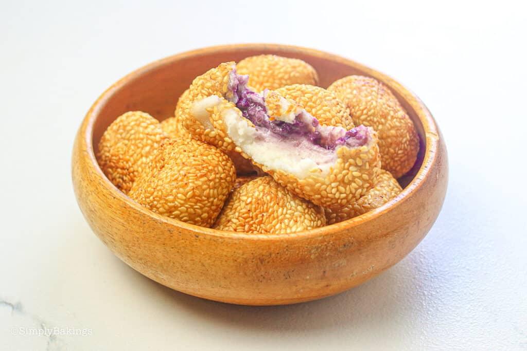 delicious ube buchi (purple yam sesame balls) in a wooden bowl