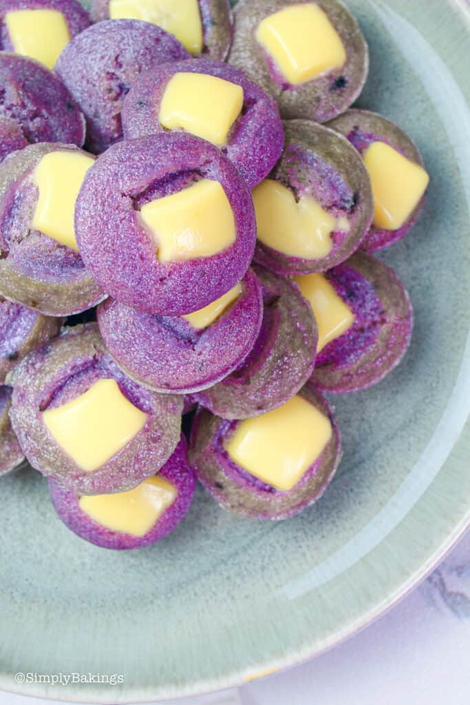 ube puto topped with cheese