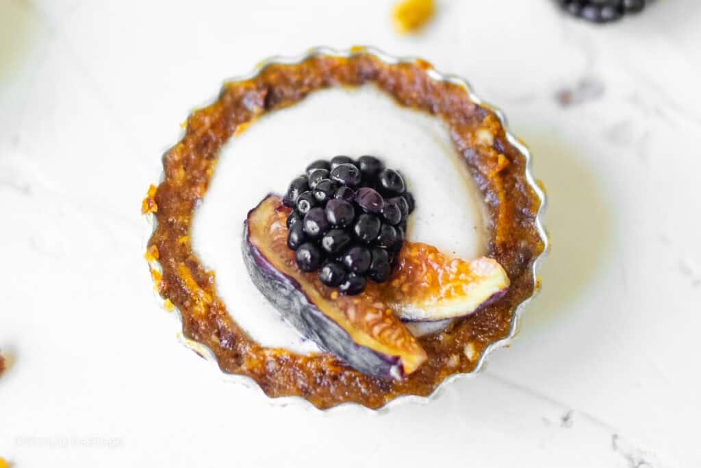 fig blackberry tart on a white table