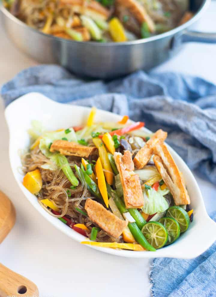 healthy and delicious vegan pancit sotanghon in a white bowl topped with fried tofu